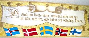 The sign has flags of the 5 scandinavian countries